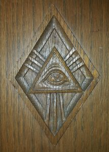 The Eye of God, one of the biblical pew carvings in our sanctuary